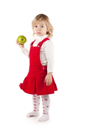 Baby girl with apple. Isolated on white background Stock Photo - 13618123