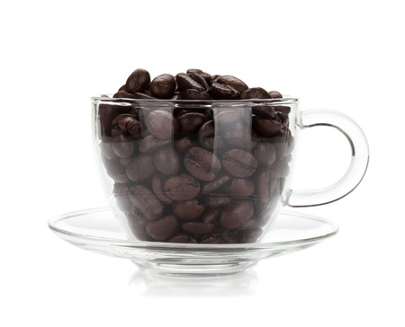 Coffee beans in glass cup. Isolated on white background photo