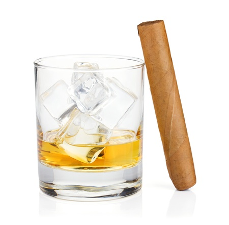 Whiskey glass and cigar  Isolated on white background photo