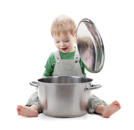 Baby looking inside saucepan  Isolated on white background photo