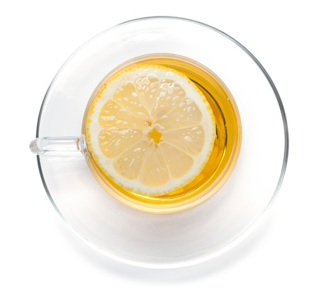 yellow tea pot: Cup of tea with lemon slice  View from above  Isolated on white background