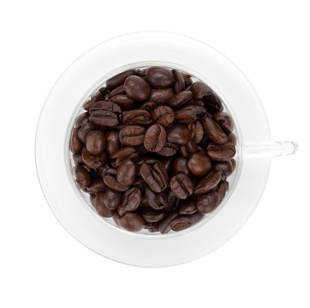 Coffee beans in glass cup  View from above  Isolated on white background photo