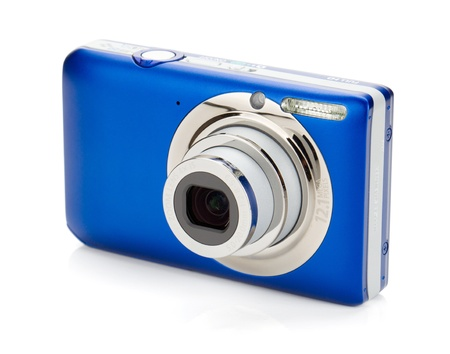 compact: Blue compact camera. Isolated on white background