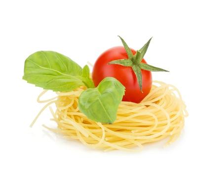 pasta isolated: Cherry tomato, basil and pasta. Isolated on white background