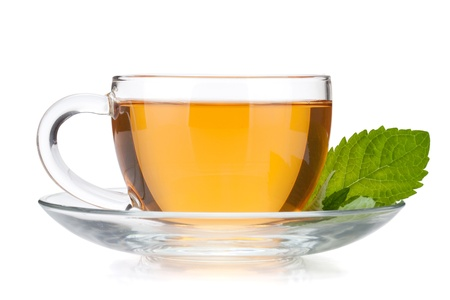 yellow tea pot: Cup of tea with mint leaves  Isolated on white background Stock Photo