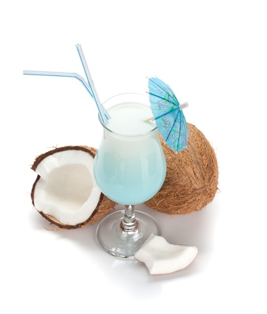 Blue hawaii cocktail and coconuts.View from above. Isolated on white background photo
