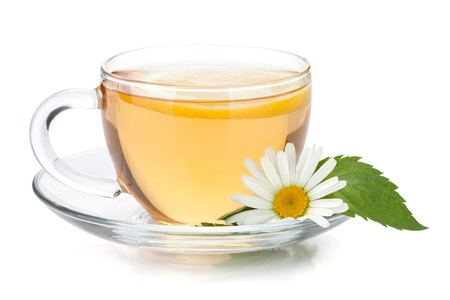 Cup of tea with lemon slice, mint leaves and chamomile flower. Isolated on white background