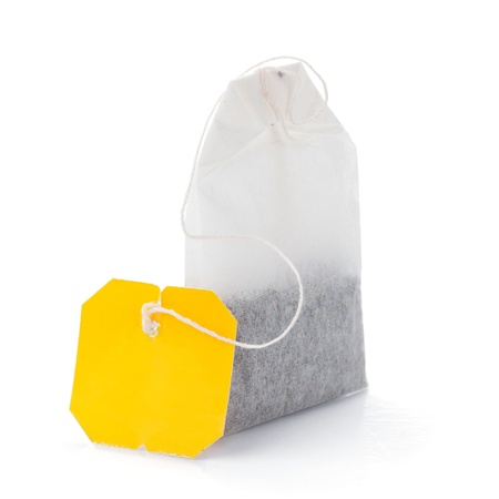 morning tea: Teabag with yellow label. Isolated on white background