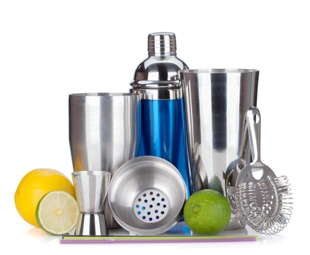 Cocktail shaker, strainer, measuring cup, drinking straws and citruses. Isolated on white background photo