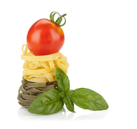 italian culture: Fettuccine nest pasta with tomato cherry on top  Isolated on white background