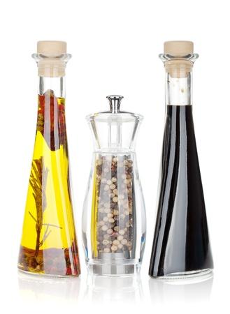 vinegar bottle: Olive oil, pepper shaker and vinegar. Isolated on white background