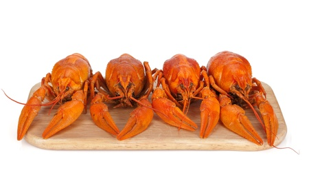Boiled crayfishes on cutting board. Isolated on white background Stock Photo - 15158462