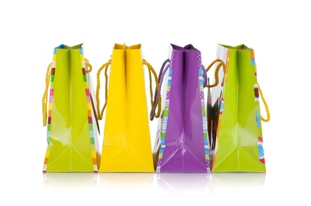 Four colored gift bags. Isolated on white background photo