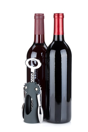 closed corks: Two red wine bottles and corkscrew. Isolated on white background Stock Photo
