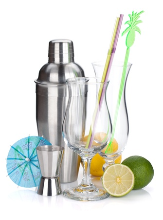 Cocktail shaker, glasses, utensils and citruses. Isolated on white background