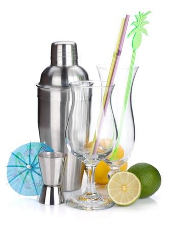 bar tool: Cocktail shaker, glasses, utensils and citruses. Isolated on white background