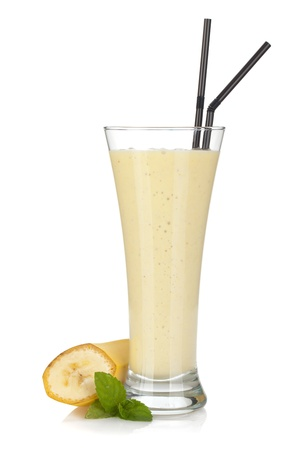 milk shake: Banana milk smoothie with mint and drinking straws. Isolated on white background