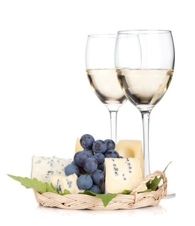 cheeseboard: Cheese, grape and two white wine glasses. Isolated on white background Stock Photo