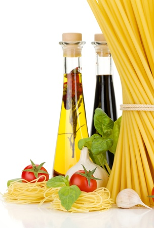 Pasta, tomatoes, basil, olive oil, vinegar, garlic and parmesan cheese. Isolated on white background Stock Photo - 15390027