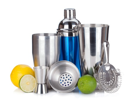 bar tool: Cocktail shaker, strainer, measuring cup, drinking straws and citruses. Isolated on white background Stock Photo