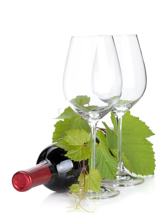 merlot: Red wine bottle and empty glasses. Isolated on white background