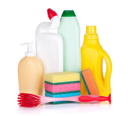 Plastic bottles of cleaning products, sponges and brush  Isolated on white background photo