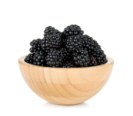 mix fruit: Blackberry in wooden bowl  Isolated on white background Stock Photo