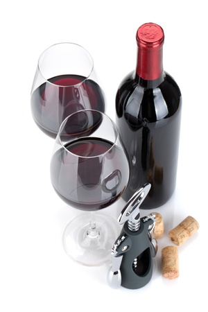 merlot: Red wine, corks and corkscrew  Isolated on white background, view from above, focus on glasses