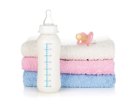 Baby bottle, pacifier and towels. Isolated on white background Stock Photo - 15788081