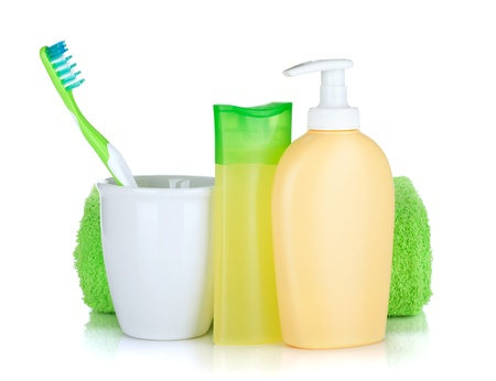 Toothbrush, cosmetics bottles and towel. Isolated on white background photo