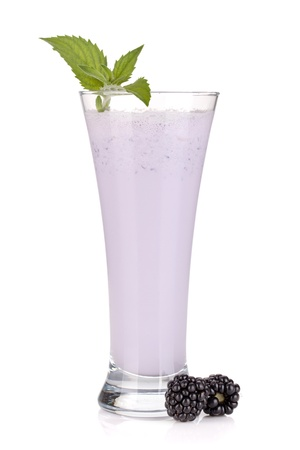 Blackberry milk smoothie with mint. Isolated on white background photo