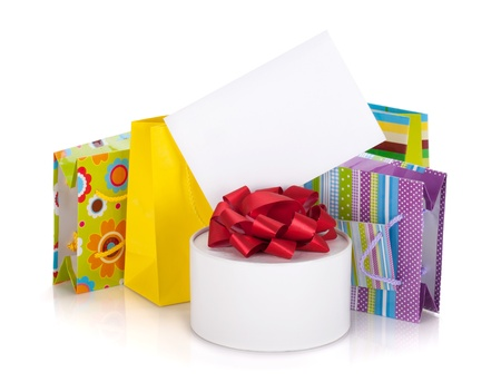 Colored gift bags, box and greeting card. Isolated on white background photo