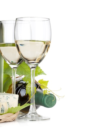 alcohol bottle: White wine glasses and cheese. Closeup. Isolated on white background Stock Photo