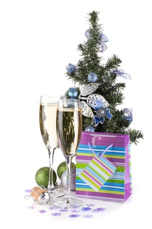Champagne glasses, firtree and christmas decor. Isolated on white background photo