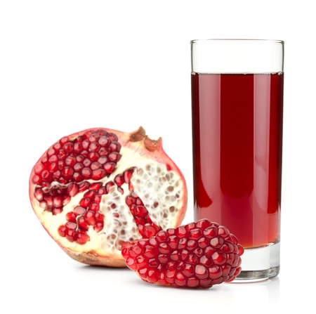 pomegranate juice: Pomegranate juice in a glass and ripe pomegranate. Isolated on white background