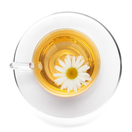 Cup of tea with chamomile flower. View from above. Isolated on white background photo