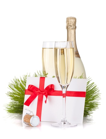 Champagne and gift letter. Isolated on white background photo