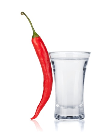 Shot of vodka and red hot chili pepper. Isolated on white background Stock Photo - 16245066