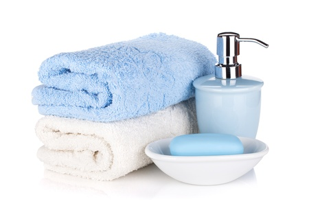 bath cream: Soap and two towels. Isolated on white background