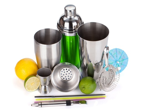 cocktail strainer: Cocktail shaker, strainer, measuring cup, drinking straws and citruses. Isolated on white background Stock Photo