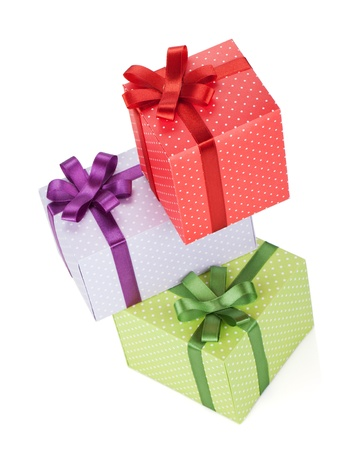 Three gift boxes with ribbon and bow. Isolated on white background photo