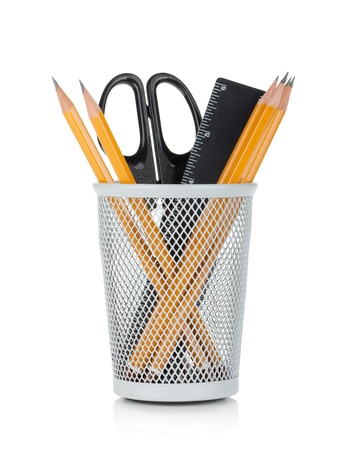 pencil holder: Pencils, ruler and scissors in holder. Isolated on white background