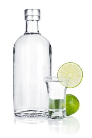 Bottle of vodka and shot glass with lime slice  Isolated on white background Stock Photo - 16538364