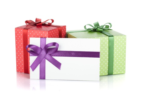 Colorful gift boxes and letter with ribbon and bow  Isolated on white background Stock Photo