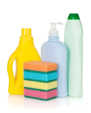 Plastic bottles of cleaning products and sponges  Isolated on white background photo