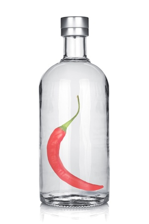 Bottle of vodka with red chili pepper  Isolated on white background Stock Photo - 16660871