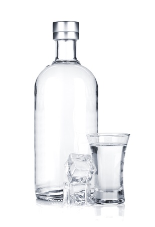 vodka bottle: Bottle of vodka and shot glass with ice. Isolated on white background