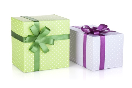 package design: Two colorful gift boxes with ribbon and bow. Isolated on white background Stock Photo