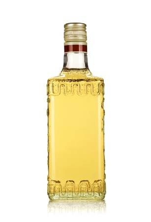 Bottle of gold tequila. Isolated on white background photo