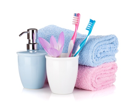 Toothbrush, soap, two towels and flower  Isolated on white background photo
